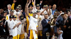 17 June 2010:  Guard Kobe Bryant and the Los Angeles Lakers celebrates as ESPN's Stewart Scott presents Ervin Magic Johnson the Larry O'Brien trophy after the Lakers defeat the Boston Celtics 83-79 and win the NBA championship in Game 7 of the NBA Finals at the STAPLES Center in Los Angeles, CA.